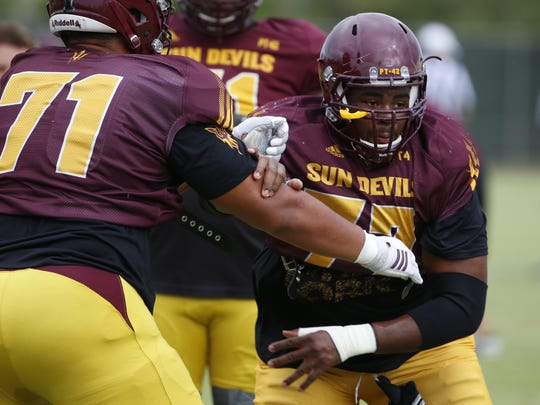 Offensive lineman Stephon McCray (right) is working at first-team center on ASU's rebuilt O-line.