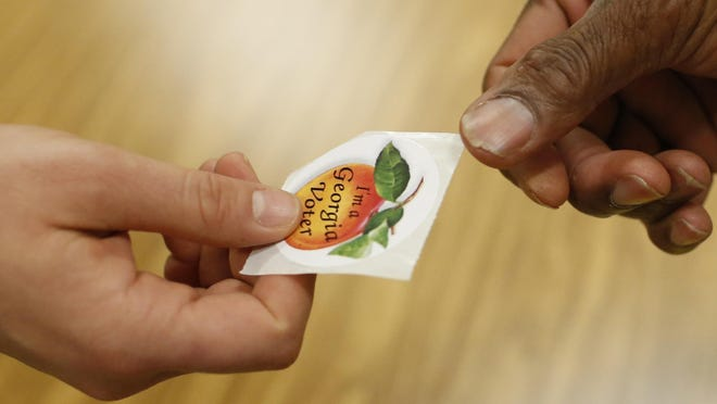 Getting the peach voting sticker will be one of the few familiar parts of the voting experience on June 9.