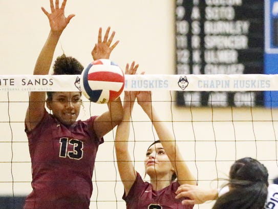 Ebonie Ballesteros, 13, of El Dorado rejects a shot