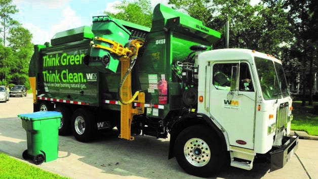 This is a McNeilus ZR automated trash truck operated by Waste Management.