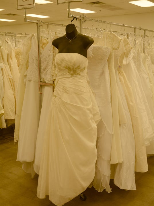 Getting married brides score bargains at mesa goodwill for Discount wedding dresses arizona
