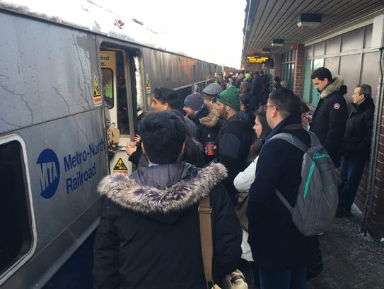 8.23 a.m. Commuters cram on the express Manhattan-bound