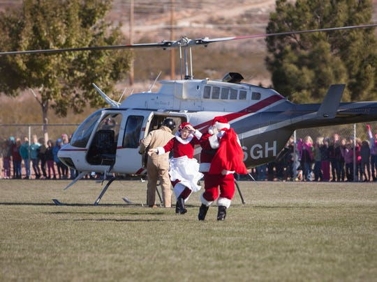 Santa and Mrs. Claus arrive by helicopter at Hurricane