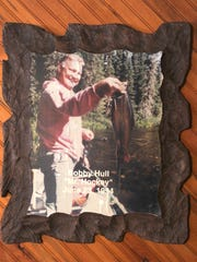 This framed photograph of hockey great Bobby Hull holding a big brook trout caught in 1994 in the Albany River system hangs in Miminiska Lodge on Miminiska Lake in northwestern Ontario.