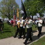A color guard posts flags during a Vietnam Veterans Recognition Day ceremony last year.