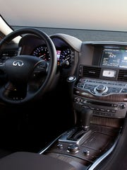 The 2014 Infiniti Q70 enhances safety with blind-spot, lane-departure, rear-camera and forward-collision alert systems.