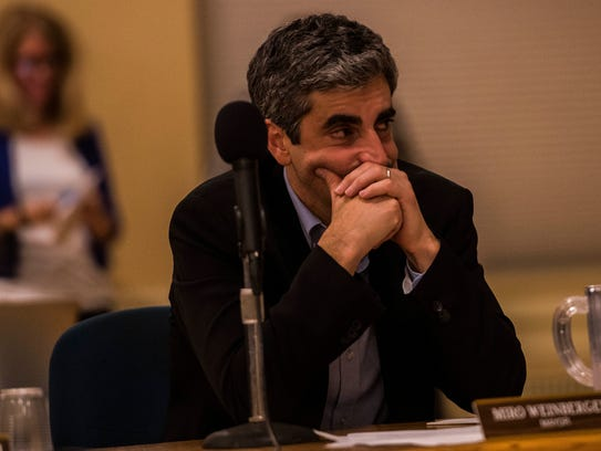 Mayor Miro Weinberger listens to a proposal from Councilor