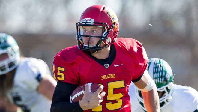 In a Nov. 1, 2014, photo provided by Ferris State University, Ferris State quarterback Jason Vander Laan, the Harlon Hill Trophy winner, scrambles during an NCAA college home football game against Lake Erie in Big Rapids.