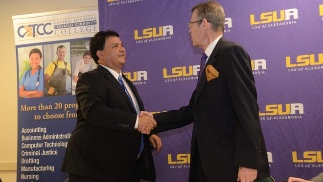 CLTCC acting Chancellor Jimmy Sawtelle (left) and LSUA Chancellor Dan Howard shake hands after signing an articulation agreement Thursday.