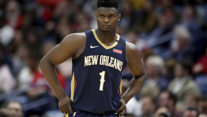 New Orleans Pelicans forward Zion Williamson walks onto the court during the second half of the team's NBA basketball game against the Miami Heat in New Orleans, Friday, March 6, 2020.