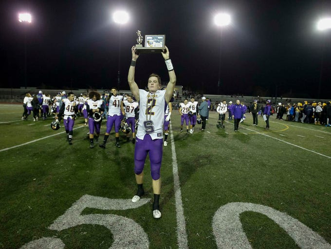 Salinas' Kelly Mcdermott hoists the championship trophy