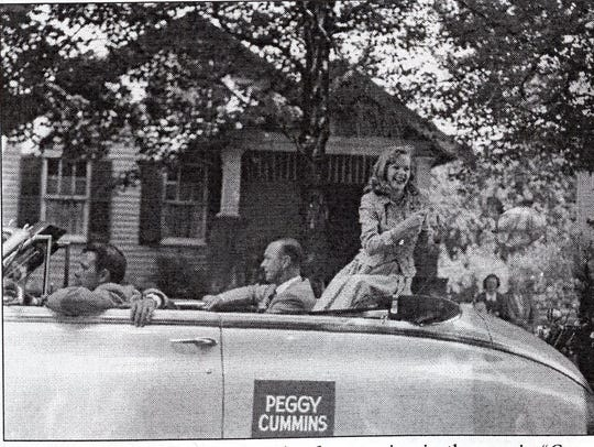 Peggy Cummins rides in a parade after starring in the