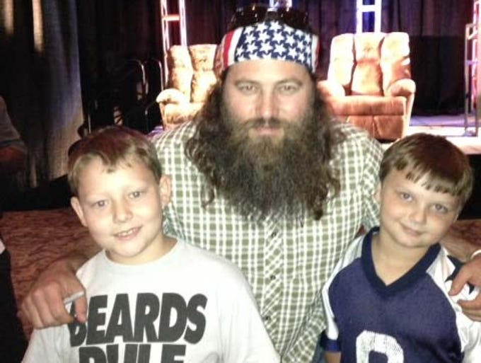 Chase McGough, left, and Jacob Gardner, right, were thrilled to meet Willie Robertson at an Independence Bowl luncheon in Shreveport.