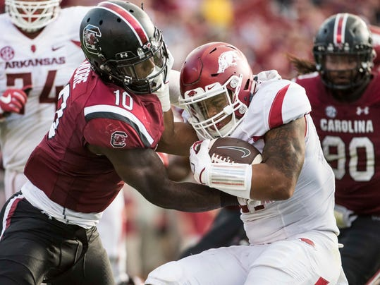Arkansas running back Devwah Whaley (21) is tackled by South Carolina linebacker Skai Moore (10) during the first half of an NCAA college football game Saturday, Oct. 7, 2017, in Columbia, S.C. (AP Photo/Sean Rayford)