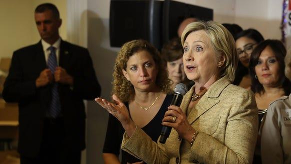 Rep. Debbie Wasserman Schultz, D-Fla., looks on as