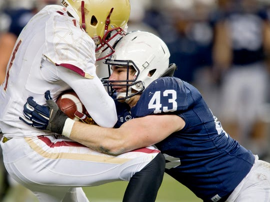Penn State's Mike Hull (43) stops Boston College's Shakim Phillips during the New Era Pinstripe Bowl at Yankee Stadium in New York on Saturday, Dec. 27, 2014. Penn State defeated Boston College, 31-30, in overtime. (Abby Drey/Centre Daily Times/TNS)