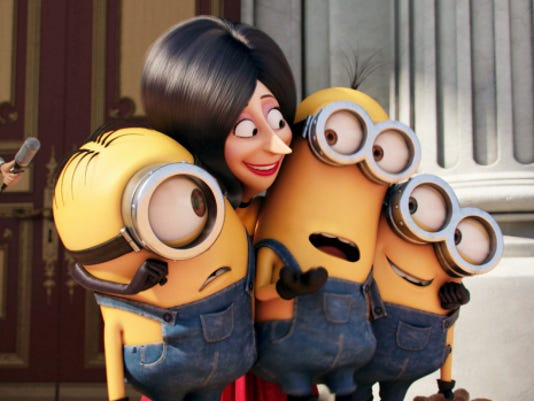 """In this image released by Universal Pictures, Scarlet Overkill, voiced by Sandra Bullock, second left, appears with minions Stuart, left, Kevin and Bob, right, in a scene from the animated feature, """"Minions."""""""