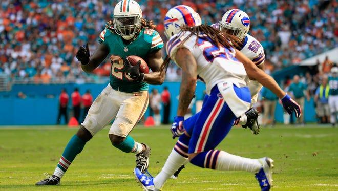 Miami running back Jay Ajayi has topped 1,000 yards rushing for the season.