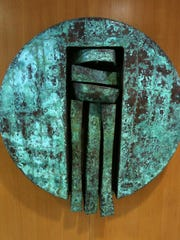 "This copper and wood piece ""Round Form"" by Melvin Schuler is on display near the Oregon State Capitol's southeast entrance from State Street."