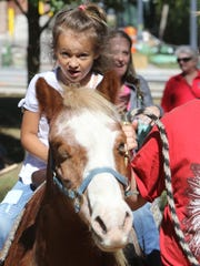 Natalie Rodriguez rides a pony during a previous year of Greendale's Oktoberfest.