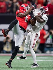 Alabama defensive back Tony Brown (2) intercepts a pass intended for Georgia wide receiver Javon Wims (6) in first half action of the College Football Playoff National Championship Game in the Mercedes Benz Stadium in Atlanta, Ga., on Monday January 8, 2018.