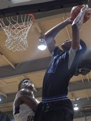 Red River's Jesse Davis goes high for a shot against