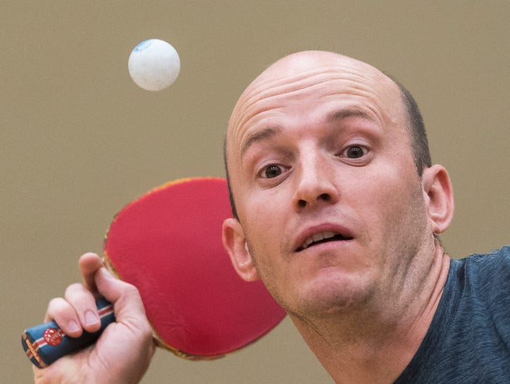 Dale Majors serves the ball at the table tennis finals