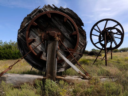 Remnants of oil boom-era derricks and their equipment