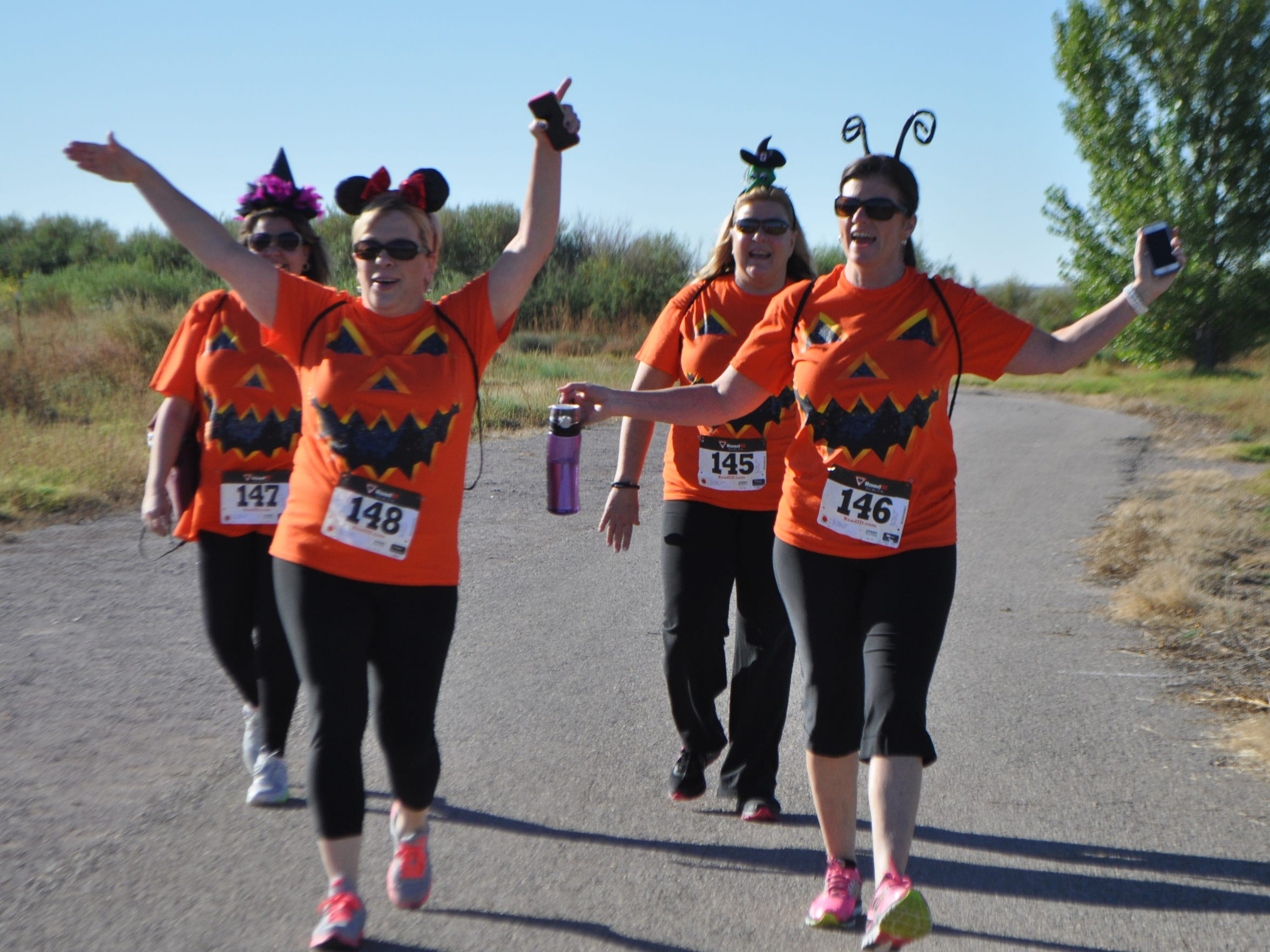 Participants sport their Halloween spirit as they walk in the 2014 Las Cruces Monster Run at La Llorona Park.