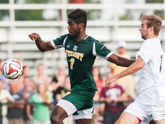Vermont's Brian Wright (7) battles for the ball with LaSalle's David Keen (18) during the men's soccer game at Virtue Field on Sept. 5, 2014.