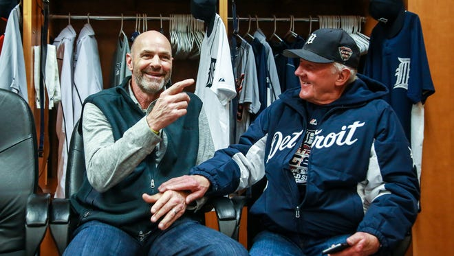 Detroit Tigers legend Kirk Gibson has a laugh with Richard Dvorsky, 76, of Grosse Ile after he admits to stealing his jersey, during the Detroit Tigers' TigerFest at Comerica Park in Detroit on Saturday, Jan. 23, 2016.