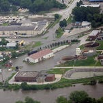 The Iowa River overflows its banks near the intersection of Clinton Street and Kirkwood Avenue in Iowa City on June 12, 2008.