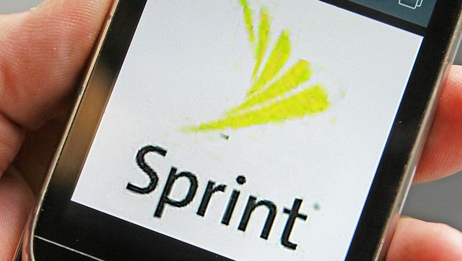 File photo taken in 2013 shows a Sprint logo is displayed on a smart phone in Montpelier, Vt.