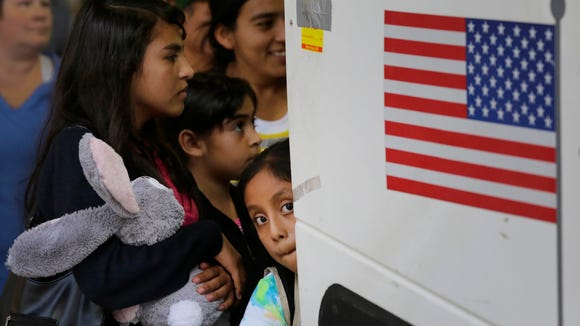 In this July 7, 2015 file photo, immigrants from El