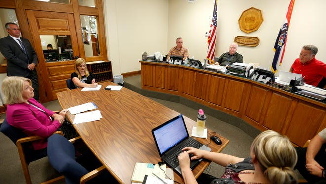 The Christian County Commission held an emergency meeting to appoint an interim county auditor on Tuesday, July 25, 2017, a day after auditor Lacey Hart was escorted from her office in the Christian County Courthouse by sheriff's deputies.