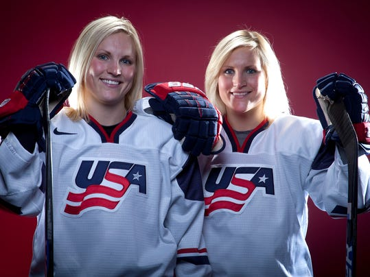 FILE - In this Oct. 2, 2013, file photo, United States Olympic Winter Games Hockey players Jocelyne Lamoureux, left, and Monique Lamoureux pose for a portrait at the Team USA Media Summit in Park City, Utah. Monique Lamoureux-Morando and twin sister Jocelyne Lamoureux-Davidson, members of the U.S. women's national hockey team, are so ready to start training for the 2018 Winter Olympics that not even driving from North Dakota to Tampa is daunting. (AP Photo/Carlo Allegri, File)