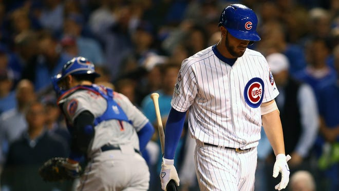 Cubs third baseman Kris Bryant (17) reacts after striking out in the fifth inning against the New York Mets in Game 4 of the NLCS at Wrigley Field.