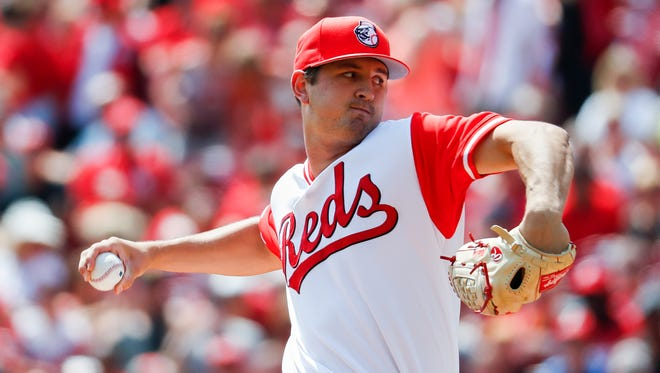 Cincinnati Reds starting pitcher Tyler Mahle throws in the first inning of a baseball game against the Pittsburgh Pirates, Sunday, Aug. 27, 2017, in Cincinnati. (AP Photo/John Minchillo)