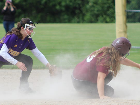 Seaholm junior Abby Righter (13) slides safely into