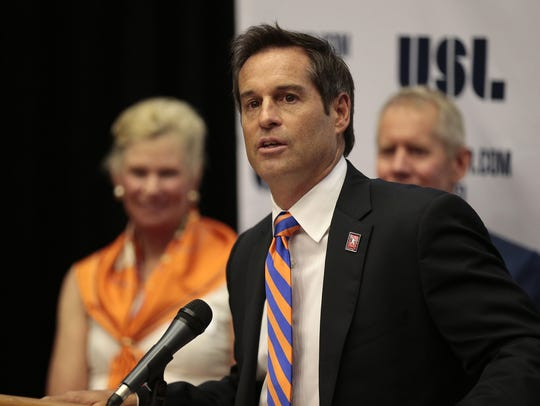 Head coach John Harkes speaks at a press conference