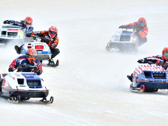 Snowmobile racers compete during the Wausau Vintage Snowmobile races at the Wausau 525 track in Rib Mountain.