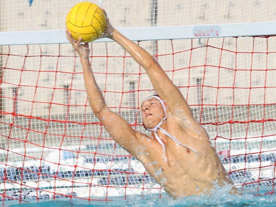 Xavier Prep's goalie, Justin Wickstrand, makes a save against Crescenta Valley at Palm Desert Aquatic Center on October 31, 2017. Xavier Prep advances to the second round of the CIF postseason play.