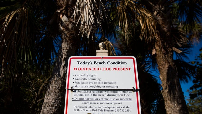 Signs indicate the presence of red tide on Tuesday, April 17, 2018, at Barefoot Beach Preserve County Park. Florida Fish and Wildlife Conservation Commission has reported that red tide persists in Southwest Florida.