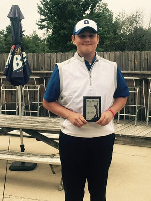 Ontario senior Marc Wilkins Jr. with his medalist plaque after shooting a one-over 73 in the McLean Invitational.