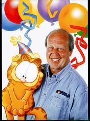 Jim Davis, right, with Garfield