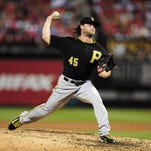 Sep 6, 2015; St. Louis, MO, USA; Pittsburgh Pirates starting pitcher Gerrit Cole (45) pitches to a St. Louis Cardinals batter during the sixth inning at Busch Stadium. Mandatory Credit: Jeff Curry-USA TODAY Sports