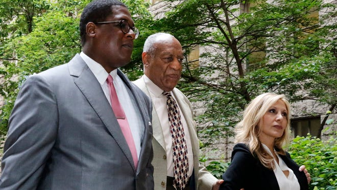 Bill Cosby arrives with one of his attorneys, Angela Agrusa, for the second day of jury selection in his sexual assault case at the Allegheny County Courthouse, May 23, 2017, in Pittsburgh.
