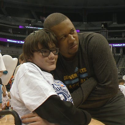 """Nuggets head coach Melvin Hunt tries on a """"serious"""