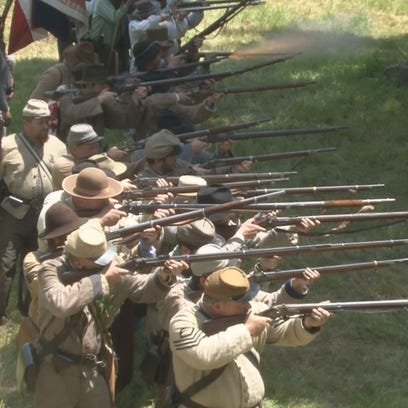 Confederate forces prepare to fire a volley at Union