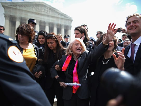 WASHINGTON, DC - MARCH 27:  Edith Windsor (C), 83, is mobbed by journalists and supporters as she leaves the Supreme Court March 27, 2013 in Washington, DC. The Supreme Court heard oral arguments in the case 'Edith Schlain Windsor, in Her Capacity as Executor of the Estate of Thea Clara Spyer, Petitioner v. United States,' which challenges the constitutionality of the Defense of Marriage Act (DOMA), the second case about same-sex marriage this week.  (Photo by Chip Somodevilla/Getty Images) ORG XMIT: 164256121 ORIG FILE ID: 164726422